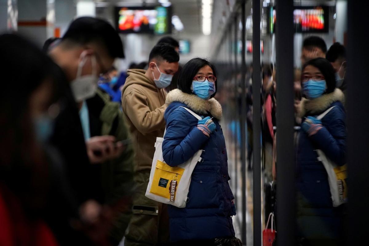 People wearing masks are seen at a subway station in Shanghai