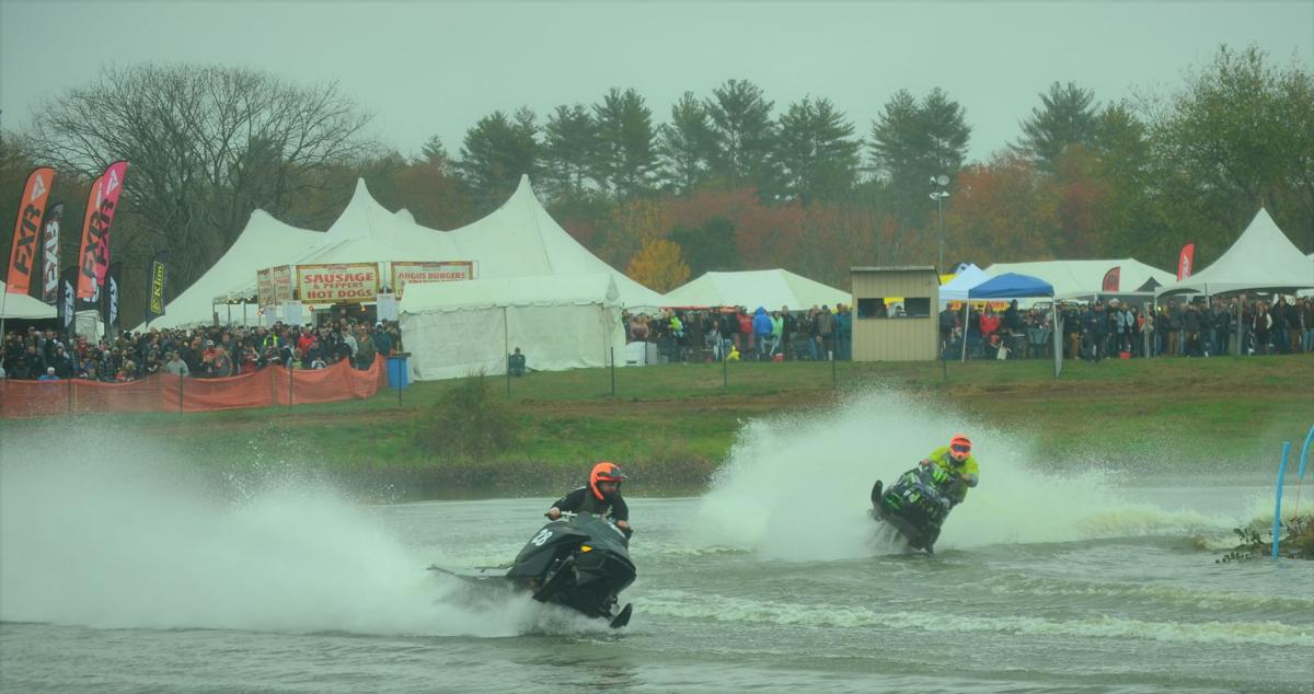 Racers compete in a watercross event at the Grass Drags in Fremont