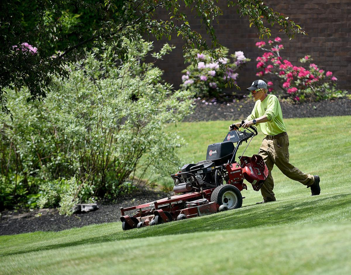 Happy Employee Mowing