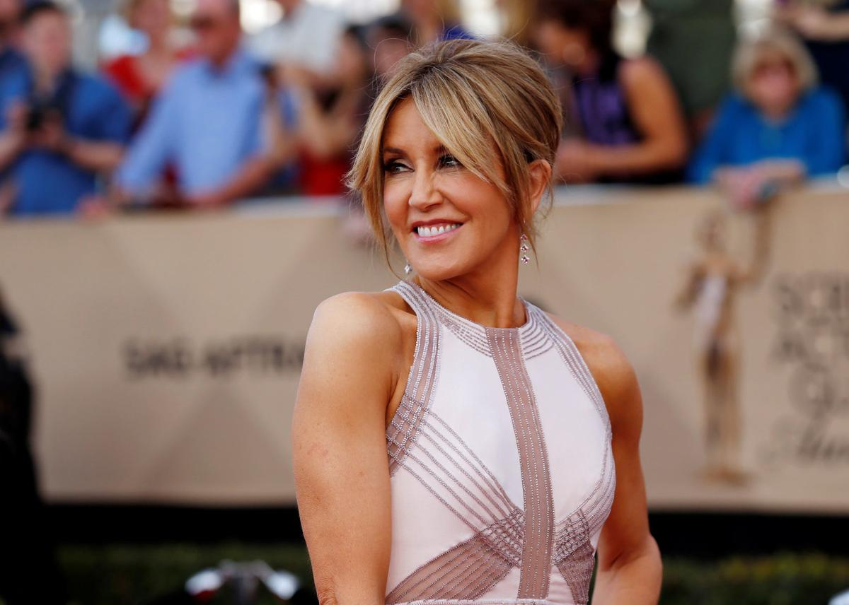 FILE PHOTO: Felicity Huffman arrives at the 23rd Screen Actors Guild Awards in Los Angeles