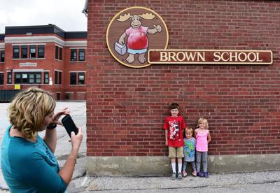 Brown School mom and kids