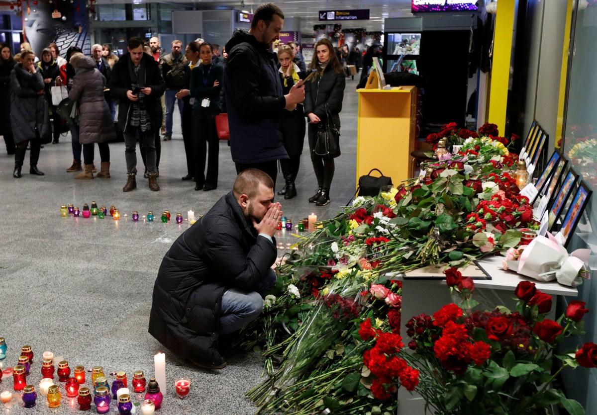 Relatives of the flight crew members of the Ukraine International Airlines Boeing 737-800 plane that crashed in Iran, mourn at the Boryspil International airport