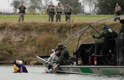 U.S. border patrol boat rescues migrants crossing the Rio Bravo towards the United States, seen from Piedras Negras