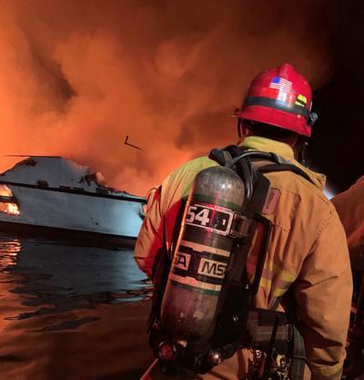 Ventura County Fire Department personnel respond to a boat fire off Santa Cruz Island