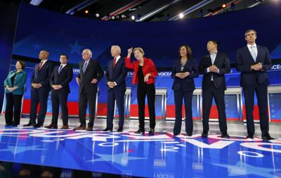 Candidates pose before the start of the 2020 Democratic U.S. presidential debate in Houston