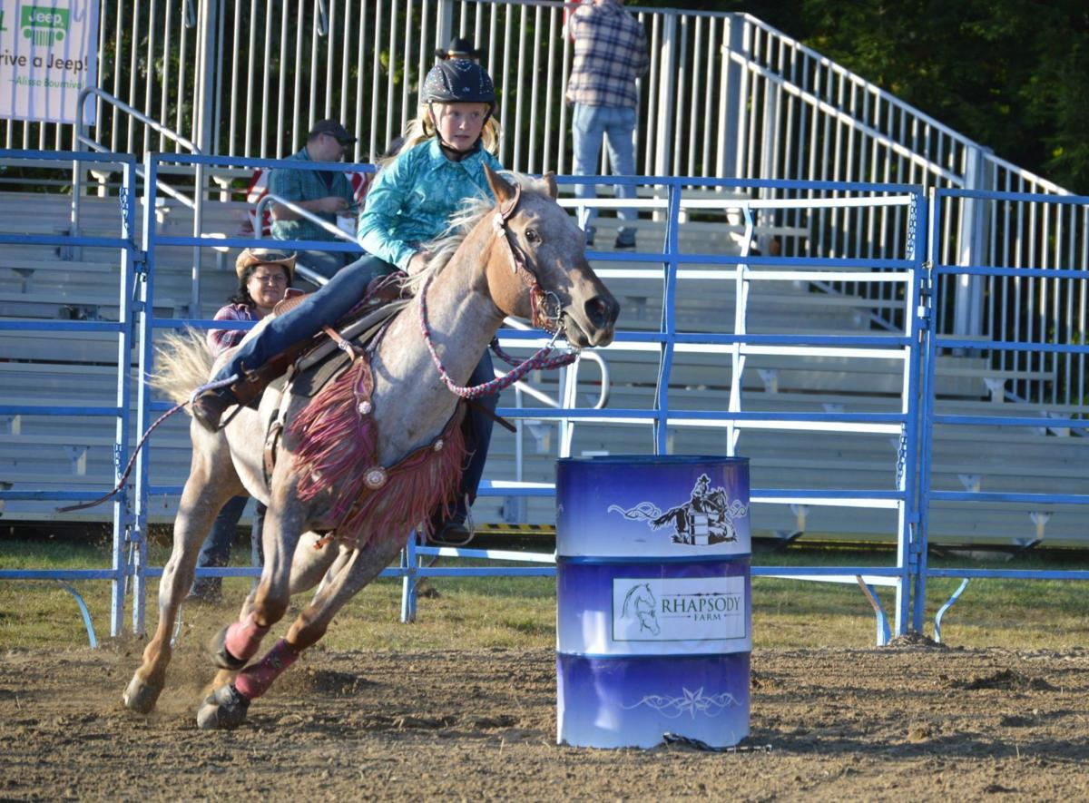 Kassidy Gladu, 12, of Chester, competes in a barrel race
