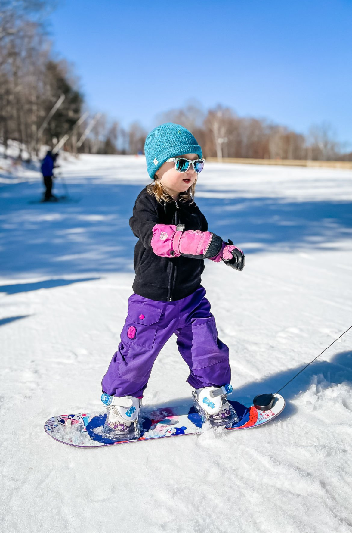 Nora on her snowboard