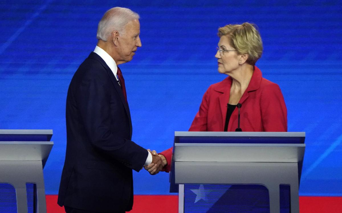 Former Vice President Biden shake hands with Senator Warren at the conclusion of  the 2020 Democratic U.S. presidential debate in Houston, Texas, U.S.