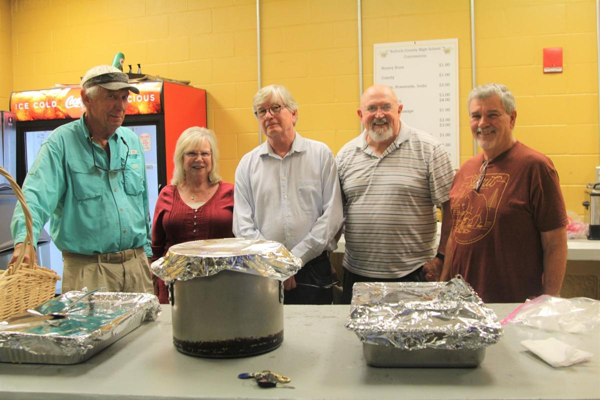 Jenks Parker, Janice Nelson, Lynn Jinks, Pastor Gene Nelson and Bob Wynn, from the Union Springs First United Methodist Church, fed the Bullock County High School football team before the spring football game.