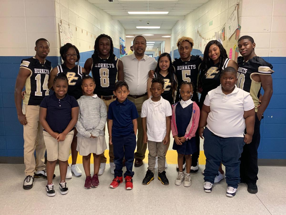 Pictured with Principal Harris are Bullock County High School Football players and cheerleaders. They read books to students at Union Springs Elementary School before the spring football game.