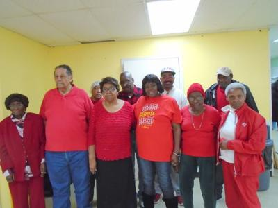 """Participants at the Union Springs Nutrition Center were asked to wear red on Friday, February 7, 2020 by the Center Manager, Terri Bean. This group posed for a photo to emphasize the """"Go Red for Women"""" movement in the battle with heart disease and heart attacks in women. (Photo by Faye Gaston)"""