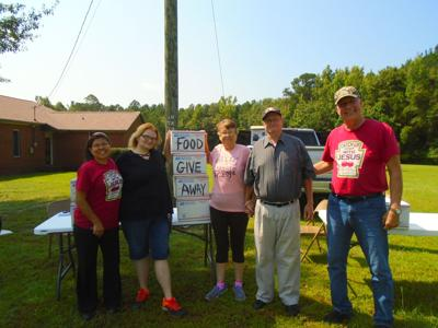 First Assembly Church, located at 946 Peachburg Road, gave away food boxes on Saturday, July 24, 2021, between 9:00 a.m. and 10:00 a.m. Left to right, Debbie Peters, Nicole Pouncey, Karen Hall, Charles Hall, and Pastor Jon Peters. (Photo by Faye Gaston)