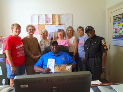 WOM members presented cards and cookies to Sheriff Raymond Rodgers and staff including the local Police Station, Sheriff's office, County Jail, City Hall and the Fire Department. This was to show appreciation for their service to the community. (Photo by Faye Gaston)