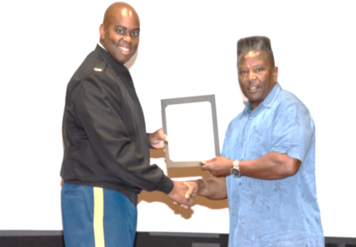 Jessie Graves receives certificate from Col Q. Noreiga.