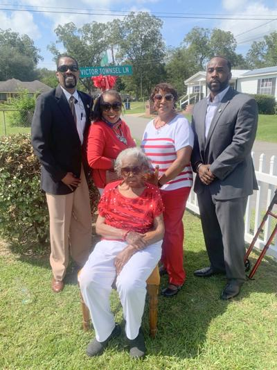 """Celebrating this very historic event pictured left to right are: Stan """"Chilly"""" Cook – City Councilman; Vivian Ivy Morrow – Granddaughter; Katie Ivy Townsel (seated) – soul surviving sibling; Jacqueline Ivy Gullette – Granddaughter; and Roderick Clark - City Councilman."""