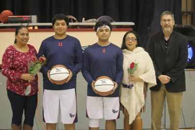Conecuh Springs Christian School recognized the senior basketball players during half time of the junior high boys game on Friday, February 7. Ruben Gudino and Joseph Munoz presented their mothers with roses and the players were presented with souvenir basketballs to honor their time playing for the Eagles. Left to right: Celia Deaquino, Ruben Gudino, Joseph Munoz, Janet Munoz Rivas, and Coach Kelly Putnam.