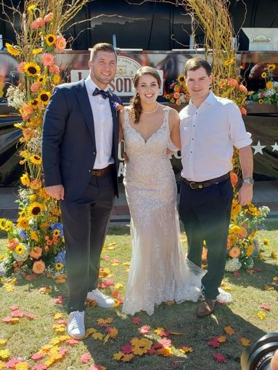 Left to right: Tim Tebow, Sophie Pierce, and Frank Pierce.