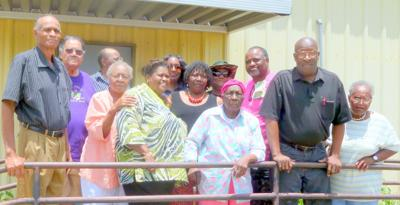 James Cox poses with some of his guests at his birthday party at the Nutrition Site on July 21, 2015.