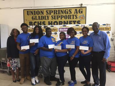 Union Springs AG owners Mr. Edwin Lewis and Mrs. Gwen Lewis awarded six graduating senior  employees with the Union Springs AG Scholarships.