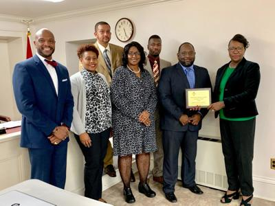 Left to right: Dr. Christopher Blair, Board Vice President Dr. Scherrie Banks, Board Member Laderick Caldwell, Board Member Alfreda Scott-Meeks, Board Member Dr. Orlando Johnson, Board President Gary Coleman, and Mary Hooks the District IV Director for the Alabama Association of School Boards.