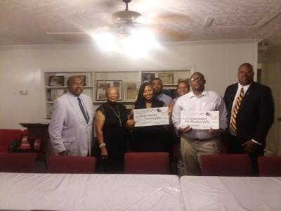 Left to Right: Mr. Robert Turner, BCVL Political Director and Chairman of Emancipation Proclamation Committee; Ms. Essie Thomas, BCVL President; Scholarship Recipient Jaliyah Robinson and her dad in background; Scholarship Recipient  Ja'Carious Robbins and his mom in background; and Mr. Prestic R. Faulk, BCVL General Secretary and scholarship committee member.