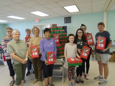 """On September 24, 2021, the Women on Mission (WOM) of First Baptist Church conducted a session to pack shoebox gifts for """"Operation Christmas Child"""" sponsored by Samaritan's Purse, a 501(c)(3) trusted Christian tax exempt charity. (Photo by Faye Gaston)"""