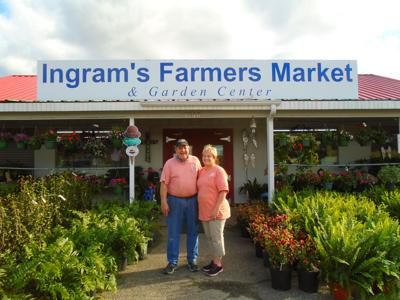 """Mike and Jo Ann Ingram, former residents of Union Springs, own the popular """"Ingram Farmer's Market"""" in Millbrook. Bullock County people shop here, and Mike and Jo Ann visit Union Springs, especially their former neighbors in the Branwood subdivision. (Photo by Faye Gaston)"""