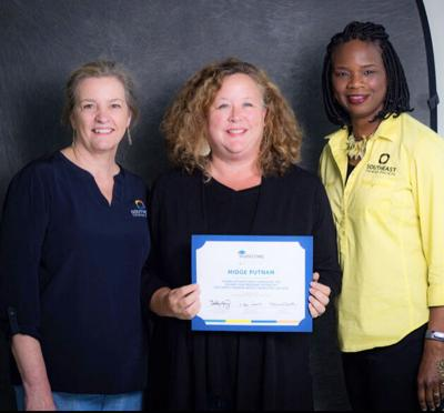 Southeast Tourism Society's Suzanne Moon and Monica Smith present Tourism Council of Bullock County's Midge Putnam with her second year certificate. Putnam joined professionals from fourteen states for Marketing College.