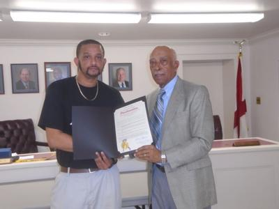 At the November 4, 2019 Union Springs City Council meeting, Union Springs Mayor Saint T. Thomas, Jr. presented a proclamation for Southern Springs Healthcare & Rehabilitation Center celebrating 25 years of service that was accepted by LaDerrick Caldwell staff member at Southern Springs. (Photo by Faye Gaston)