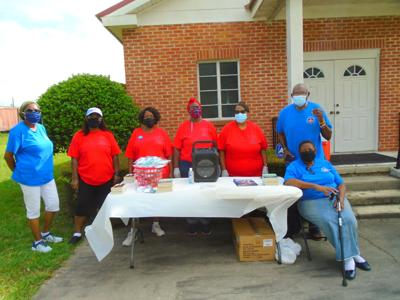 """Elder Henry L. Graham, Doris Jones and others at the First Union Springs Seventh Day Adventist Church offered prayer, a meal and free literature at the """"Drive-Thru Prayer and Meal"""" on August 28,  2021. (Photo By Faye Gaston)"""