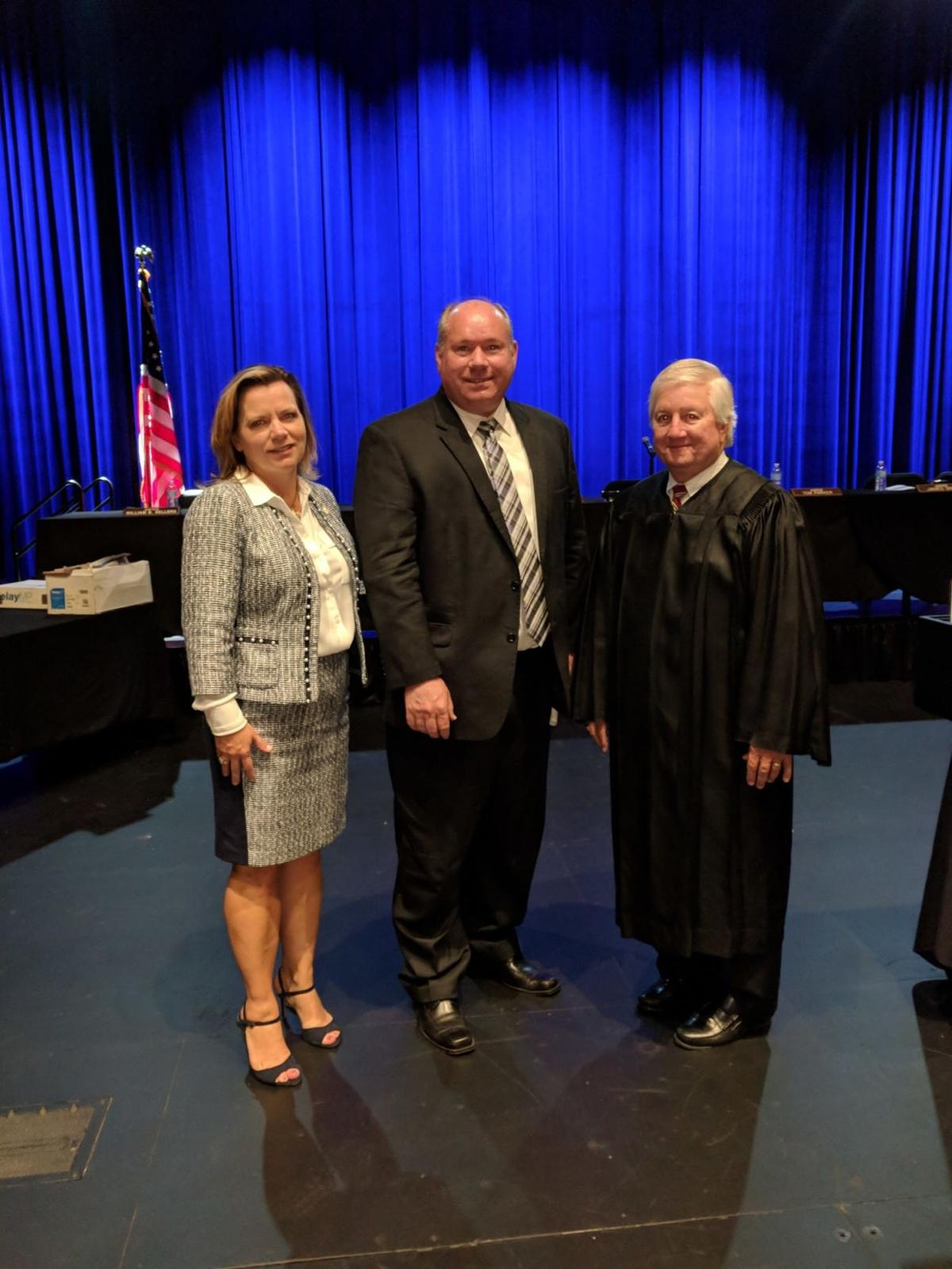 Attorney Christy Crow, Attorney Johnny Adams, and Alabama Supreme Court Justice Jim Main.