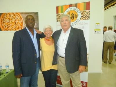 """Alonza Ellis, Jr., Bullock County Commissioner, is shown with Peggy and Jeff Sutton as he thanked them for all they are doing  for Bullock County. He said, """"You showed love for Bullock County when you chose to stay here. Now others know it is possible to build a business here as you have done."""" Photo by Faye Gaston"""