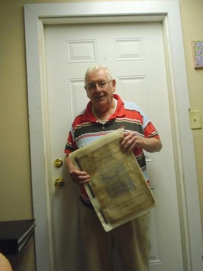 This 1903 Herald newspaper owned by Harold Benton was on display at the County Commission meeting. (Photo by Faye Gaston)