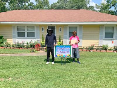 """Pastor Savannah Fitzpatrick's yard was selected as Yard of the Month by Union Springs Councilman Stan """"Chilly"""" Cooks for the month of July."""