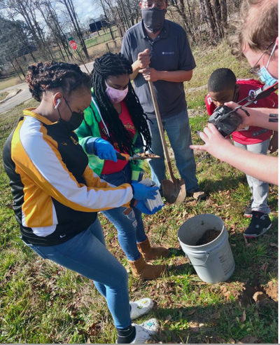 Students at South Highlands Middle School test soil with Mr. Anwar Walker, STEM teacher and 4H Lead for the School District
