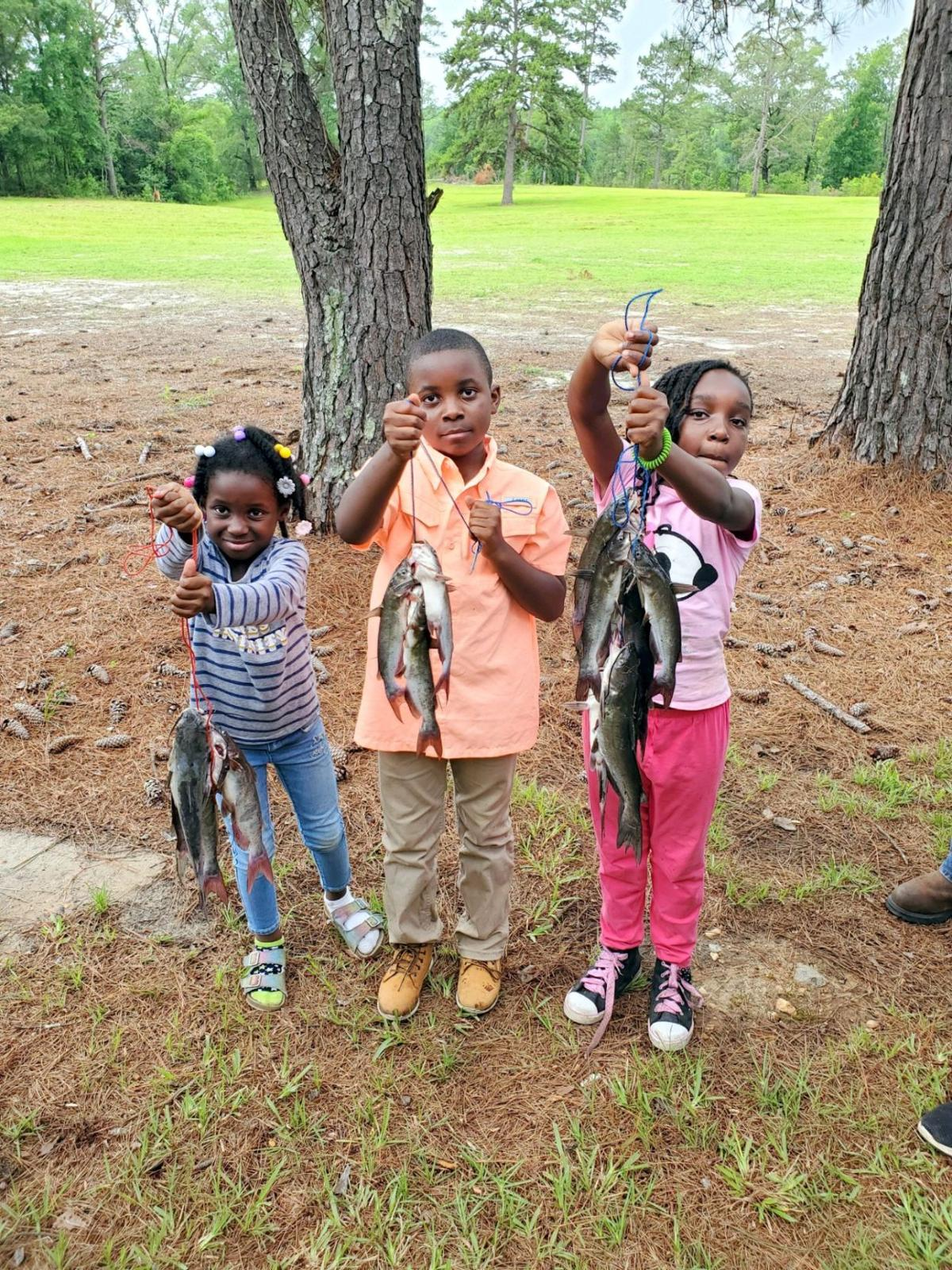 Youth anglers showing off their catch of the day.