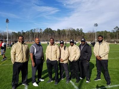 Left to right: Coach J.R. Richardson, Coach Rudy Cooper, Coach Willie Spears, Coach Marc-Anthoni Peacock, Coach Torres Vines, Coach A.T. Harris, and Coach Jeremy Vines.