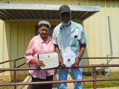 John and Lillie Williams were inducted into the State of Alabama 2021 Alabama Senior Citizens Hall of Fame on August 29, 2021, in celebration of their impressive milestone of being married 65 years and longer. Lillie holds the certificate. John holds the printed program for the scheduled induction and awards ceremony on August 29, 2021, which was canceled due to the pandemic. (Photo by Faye Gaston)