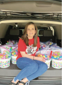Katie Griffin delivering baskets of joy, snacks, school supplies, games, and information about hand washing to her students.