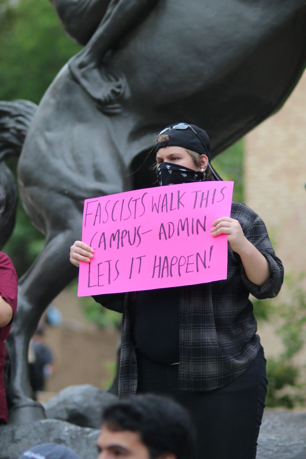 Student protester with sign