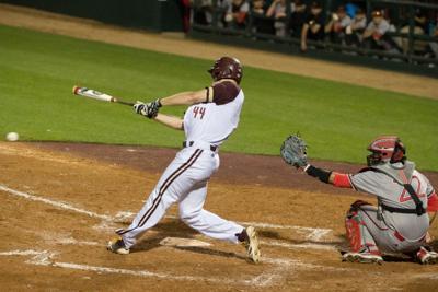 Cody Lovejoy swings the baseball bat.