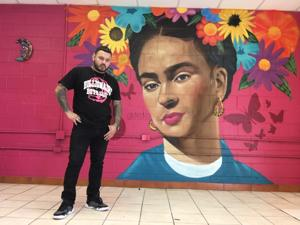 Alumnus transforms boxing lessons into knock-out murals