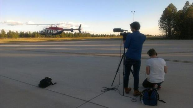 Students film the Medevac helicopter as it takes off