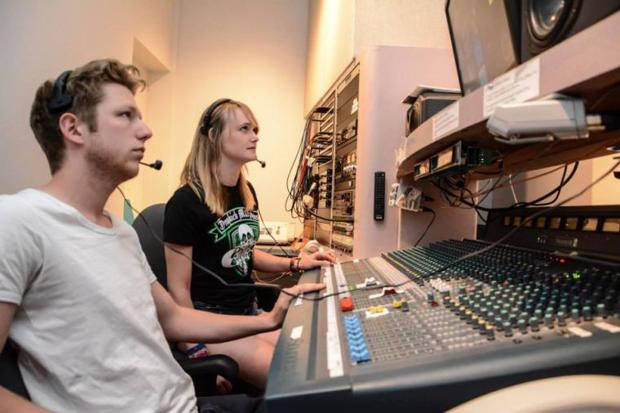 Students in the audio booth