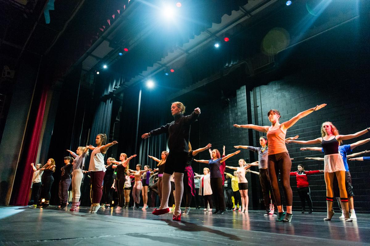 Dancers warm up before rehearsal