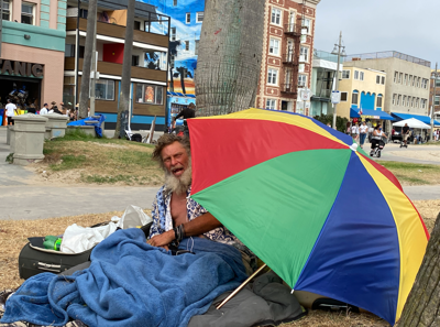 Unhoused individual set up camp on Boardwalk