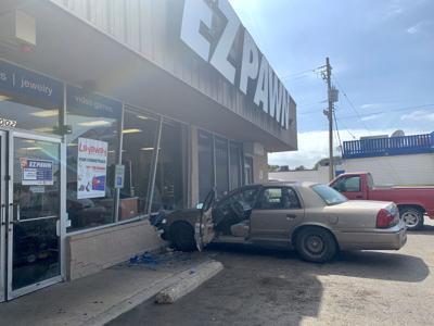 Car crashes into EZPawn on North Navarro Street