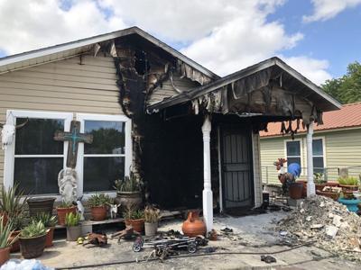 Family, dog escape Victoria house fire