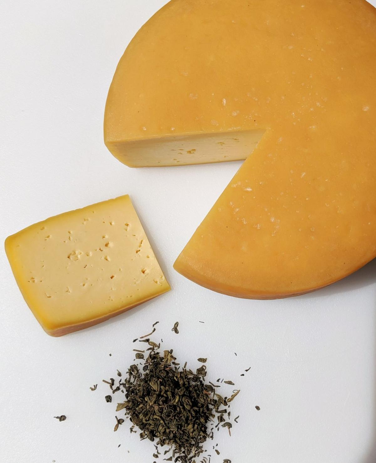 Caciotta, a seasonal cheese infused with smoked tea leaves, made fresh at Lira Rossa Artisan Cheese in Moulton.