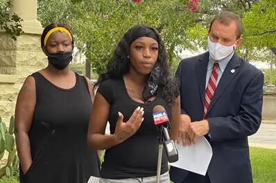 "A Texas woman says she was fired by a Whataburger in Fort Worth for wearing a Black Lives Matter face mask to work, in what is the latest in a string of penalties handed down by employers for public displays of support for the social justice movement.             Similar cases are popping up across the state and all over the country. Over the summer, two Texas teachers faced disciplinary action from their schools, one for wearing a mask and the other for displaying a Black Lives Matter sign, among other signs, in her virtual classroom.             Meanwhile in Ohio, a Taco Bell worker was fired for refusing to take off his Black Lives Matter mask; the same happened to a convenience store worker in New Jersey. And Whole Foods is being sued by 15 employees across six stores, who are accusing the Amazon-owned grocery store of firing one employee and disciplining 40 others for wearing the masks and pins at work.                          ""What we're seeing with a lot of employees, particularly during this time, is the desire to have their place of employment reflect their values,"" said Andre Segura, legal director of the American Civil Liberties Union of Texas.             The incidents come as people across the country continue to protest police brutality against Black people in the wake of the deaths of George Floyd and Breonna Taylor, who were both killed by police officers.             Ma'kiya Congious, 19, lost her job at the fast-food chain shortly after her supervisor told her to remove her Black Lives Matter mask when a white customer complained, her attorney Jason Smith said. Smith said Congious had worn the same mask to work in front of several of her managers without consequence.             A Whataburger representative said in a statement that Congious voluntarily resigned ""due to a disagreement over our company uniform policy."" The representative said her resignation was accepted and Congious was paid for the two weeks she was scheduled to work.                          Whataburger's uniform policy, which extends to face masks, does not allow ""non-Whataburger messaging,"" like that related to politics, religion or sports.             ""If we allow any non-Whataburger slogans as part of our uniforms, we have to allow all slogans,"" a Whataburger representative said in a statement.             But Congious says she didn't resign.             ""Whataburger wants you to wear a mask that has no opinions whatsoever on them, all right? I mean, you're entitled to your personal opinions, and that's fine. But at Whataburger we don't want to portray them because … some people may be offended,"" a supervisor said in a conversation taped by Congious and provided to The Texas Tribune.                          ""Whataburger doesn't want to get into anything political because we're just hamburgers and fries,"" the person on the recording continued.             Amid the heated discussion, Congious asked about putting in her two weeks' notice and was told that she no longer worked there. Congious later said she hadn't yet decided whether to quit but was effectively forced out of the job. When she remained in the store, her supervisors called the police, and five police cars showed up. Congious was not arrested, and no charges were filed against her.             Congious filed a discrimination complaint last month with the Texas Workforce Commission. In the complaint, Congious said she was let go by the fast-food restaurant because of her race and for having the words ""Black Lives Matter"" on her mask.             In the complaint, Congious pointed out that colleagues also wore face masks other than the ones provided by the company. One featured the Mexican flag, another the Gucci logo.                          In a Wednesday press release, Congious called for the company to let employees wear masks stating ""Black Lives Matter"" and to provide implicit bias training for all managers.             ""I wish I could be shocked, but the reality is that anti-Blackness is at every level of our lives. The firing of this woman for a BLM mask illustrates the hypocrisy of franchise owners who are quick to support anti-Black, anti-LGBT and anti-woman causes ... on the basis of bigoted religious beliefs. I hope she sues,"" Ashton P. Woods, founder of the Houston chapter of Black Lives Matter, said in a statement.             Whataburger is not legally allowed to discriminate against people based on identity markers like race, gender or sexuality, Segura said.             In San Antonio, art teacher Lillian White was fired from the Great Hearts Western Hills charter school about a week before classes were set to begin, reported KENS 5, the local CBS news station.                          Over the summer, White wore homemade masks with the words ""Black Lives Matter"" and ""Silence is Violence"" to in-person training sessions at the school. She even made a few for teachers who asked her if she had extra. But at one point in the summer, the school's assistant principal texted her to say the school wanted her to stop wearing the masks because ""parents will be coming around more and we don't discuss the current political climate.""             White continued to wear the masks.             ""This is human rights and it should be something that is promoted at our school. It's an excuse to not talk about it by saying this is politics, talk about it on your own time. It's just an excuse because they're uncomfortable with the conversation,"" White told KENS 5.             Great Hearts Texas said it is a violation of its policy for face coverings to have an external message. Superintendent Daniel Scoggin added in a statement to the news station that the schools stand ""with the Black community and all who are suffering.""                          This is at least the second recent instance in which a Texas teacher was penalized for displaying ""Black Lives Matter"" in a school setting. In late August, a teacher in the Roma Independent School District was temporarily placed on leave after parents complained about posters hanging in her virtual classroom.             The school reinstated the teacher after a few days with the option to keep the sign. However, the teacher declined to immediately return.             Segura said the retaliation against Texas teachers ""is very concerning"" because it negates that teachers still have a right to free speech in the classroom and sends the message that ""Black Lives Matter"" is a politically charged statement.             ""This is a very straightforward, apolitical statement of something that has been made to be seemingly controversial but really isn't,"" Segura said."